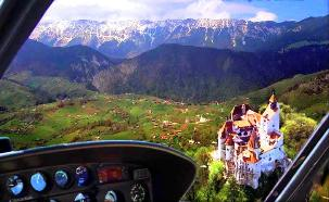 Rent a helicopter and fly over Dracula's Castle